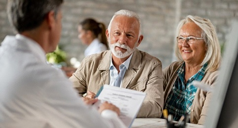 elderly couple at their dental implant consultation