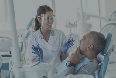 Patient talking to dentist about dental treatment options