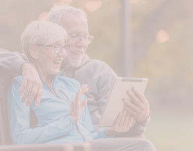 Older couple looking at information about dental services on tablet computer