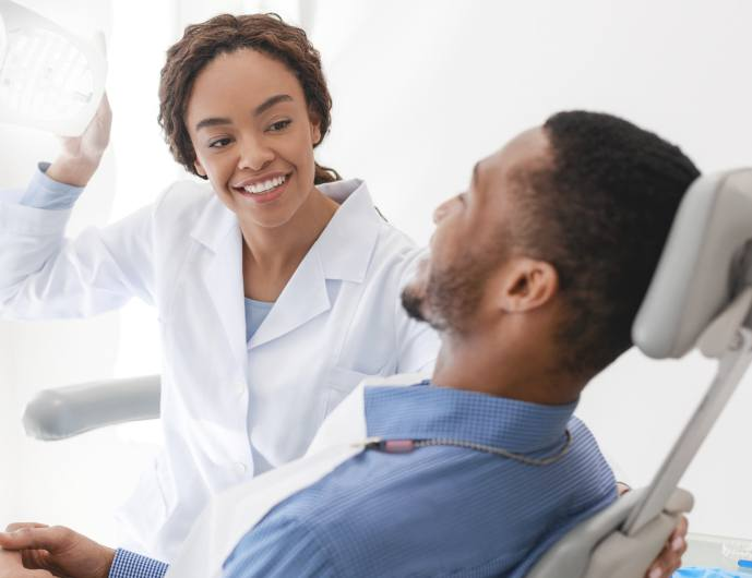 Dentist smiling at dental patient