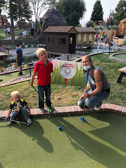 Dental team member and children playing mini golf