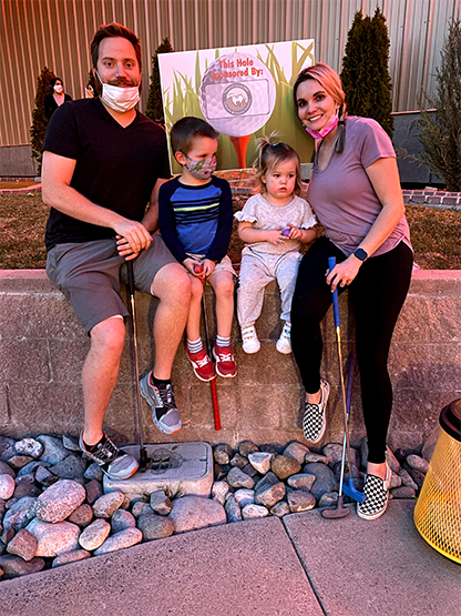 Dental team member and family at mini golf event