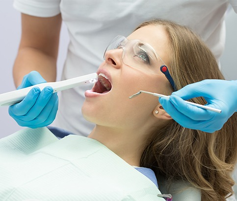 Dentist using intraoral camera to capture images